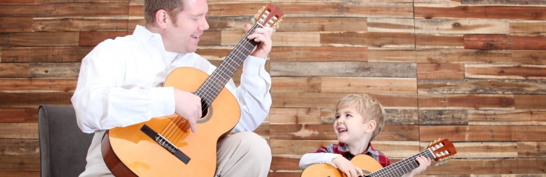 Adult and Kid Playing Guitar